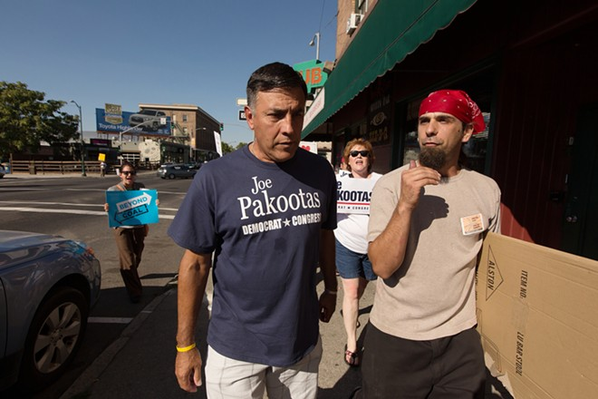 Organizer Brian Eister, right, speaks with Washington State 5th District Congressional candidate Joe Pakootas (D) while walking south on N. Division St. - YOUNG KWAK