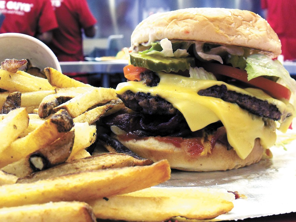 Our apologies to Carl's, Jr., but this is a six-dollar burger (actually $6.50), alongside Five Guys' non-frozen fries - HARLEY HIGHFILL