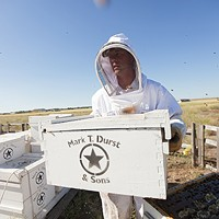 Photos: Local beekeepers and their hives Owner Mike Durst moves a hive at Mark T. Durst and Sons. Young Kwak