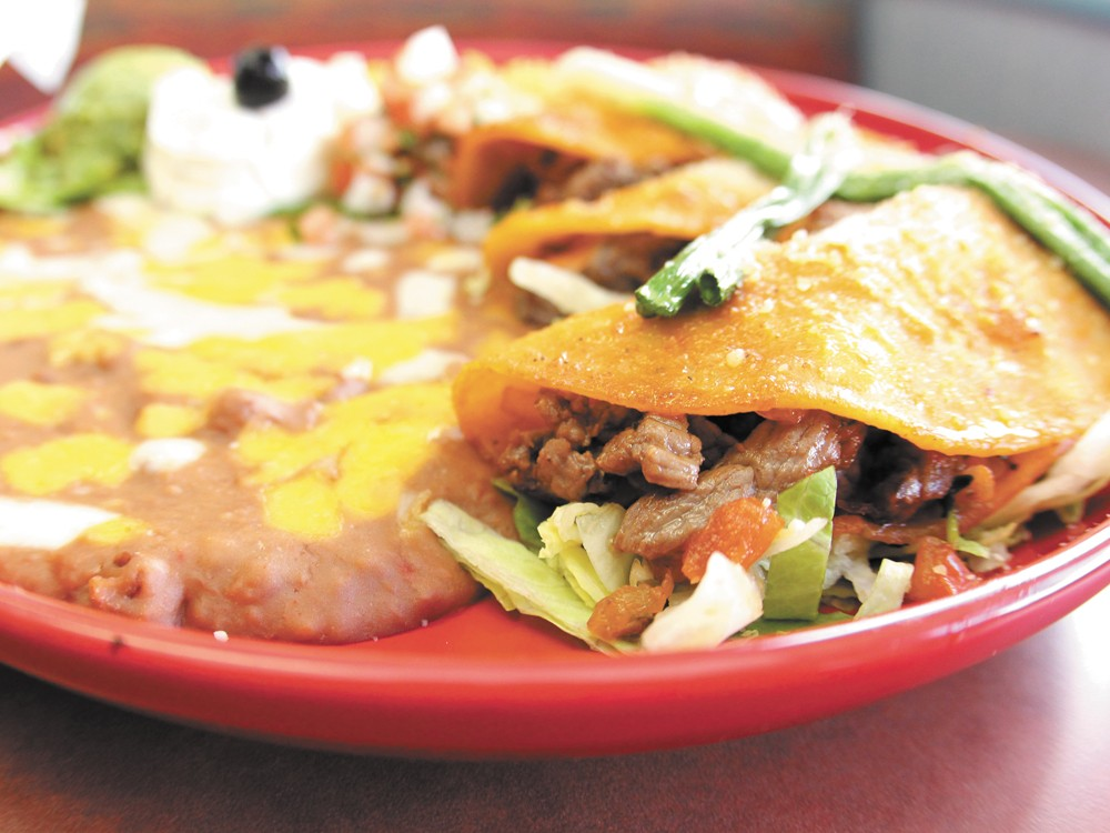 Palenque's tacos al carbon are served with beef and traditional spices - JOE KONEK