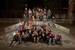 Kevin Kuest ollies among a group of UTF supporters. - MIKE MILLER