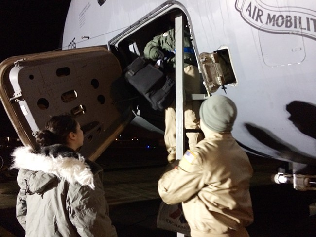 Passengers prepare to board a KC-135 after an overnight stay at RAF Lakenheath, England. - YOUNG KWAK