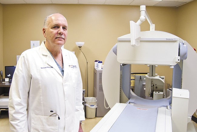Patients of Dr. Michael Ring, a cardiologist with the Providence Spokane Heart Institute, may undergo diagnostic imaging to locate blockages in their hearts. - JACOB JONES