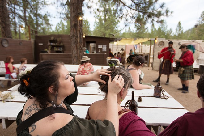 Patron Savannah Demers, left, braids Linda Stephens-Mann's hair while watching Greg Mahoney, right, and Damian Cudmore play music. - YOUNG KWAK