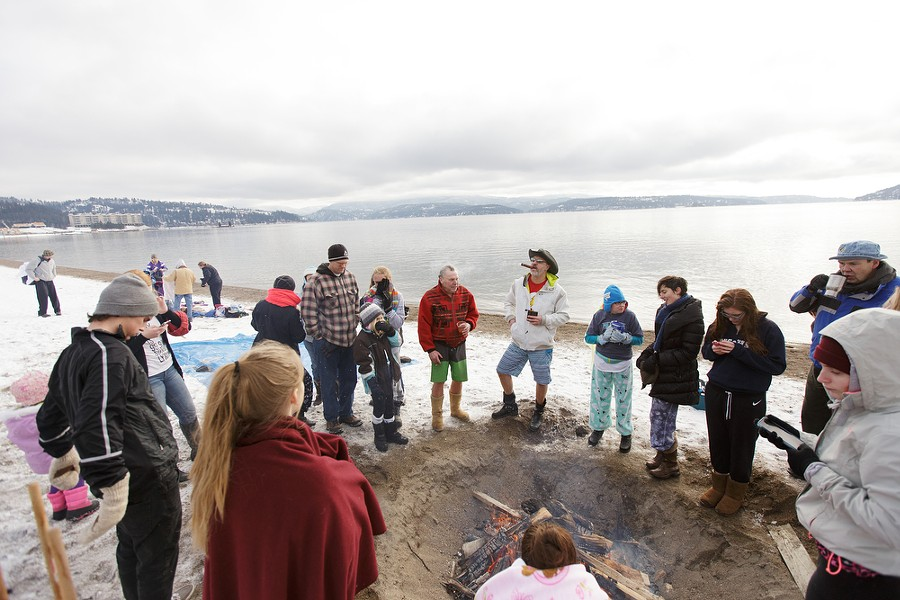 People gather around a bonfire after the Polar Bear Plunge. - YOUNG KWAK
