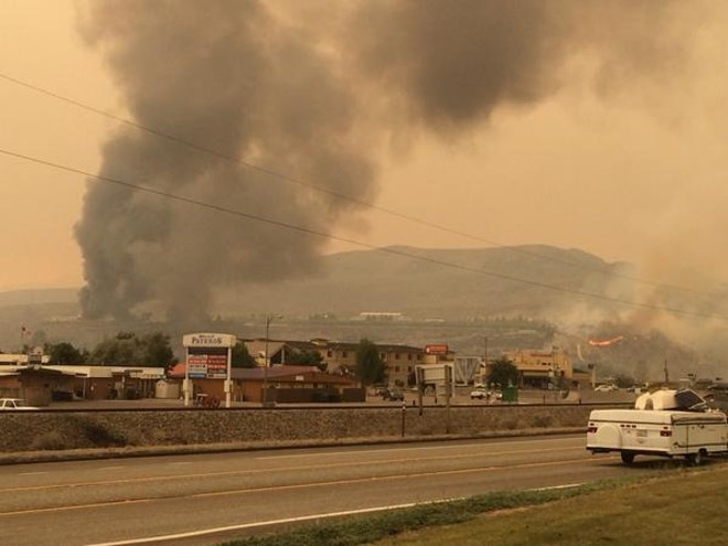 Pateros homes still ablaze. In the other direction, at least 20 homes are gone, including the pastor's of Community Church. - SCOTT LEADINGHAM