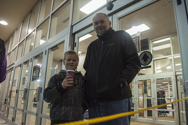Mackay Graper, left, 11, and Robert Graper had lined up outside of the South Hill Shopko at 6:30 pm to be the first customers inside the store. - SARAH WURTZ