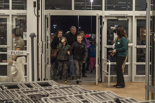 Mackay Graper, left, 11, and Payton Graper, right, 13, were the first two people in the store. - SARAH WURTZ
