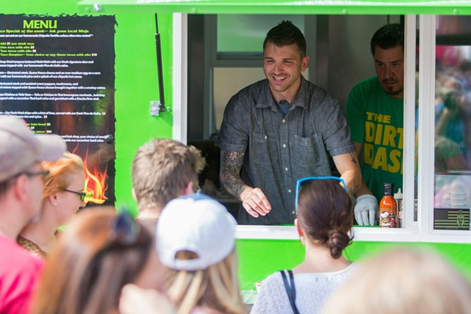 Steven Kitchnes speaks with customers at Food Truck Palooza. - MATT WEIGAND