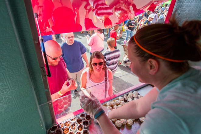 Andrew, left, and Elizabeth Sibulski order brownie bites from Love at First Bite at Food Truck Palooza. - MATT WEIGAND