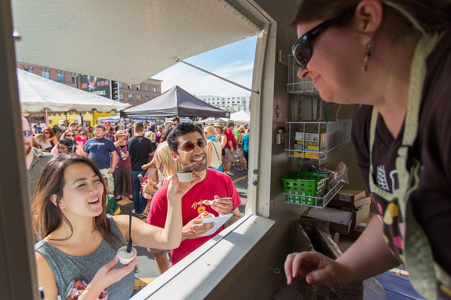 Frances Wang, left, and Shawn Chitnis order ice cream from Jennifer Davis, owner of the Scoop at Food Truck Palooza. - MATT WEIGAND