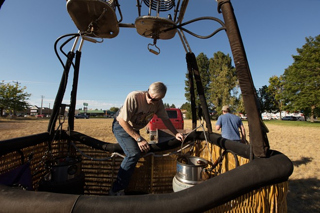Pilot and Owner Forey Walter climbs into the basket before a hot air balloon ride. - YOUNG KWAK