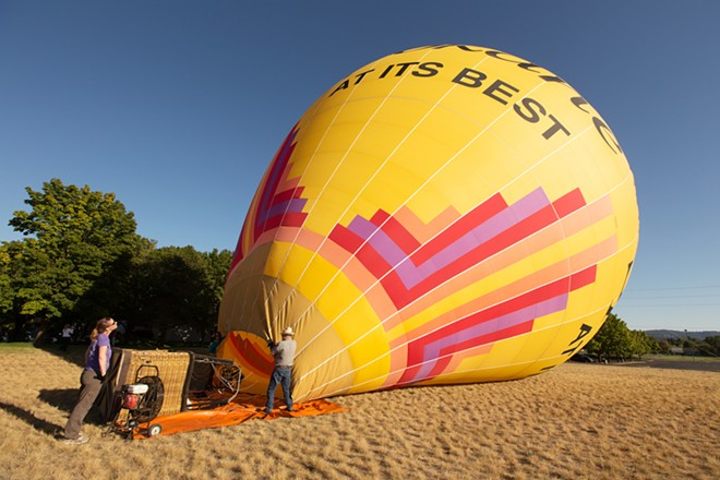 """""""Spokane At Its Finest"""" is inflated before a hot air balloon ride. - YOUNG KWAK"""