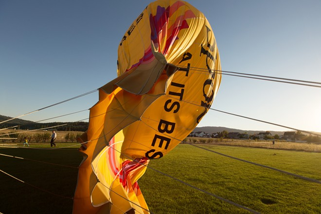 The envelope deflates after a hot air balloon ride. - YOUNG KWAK