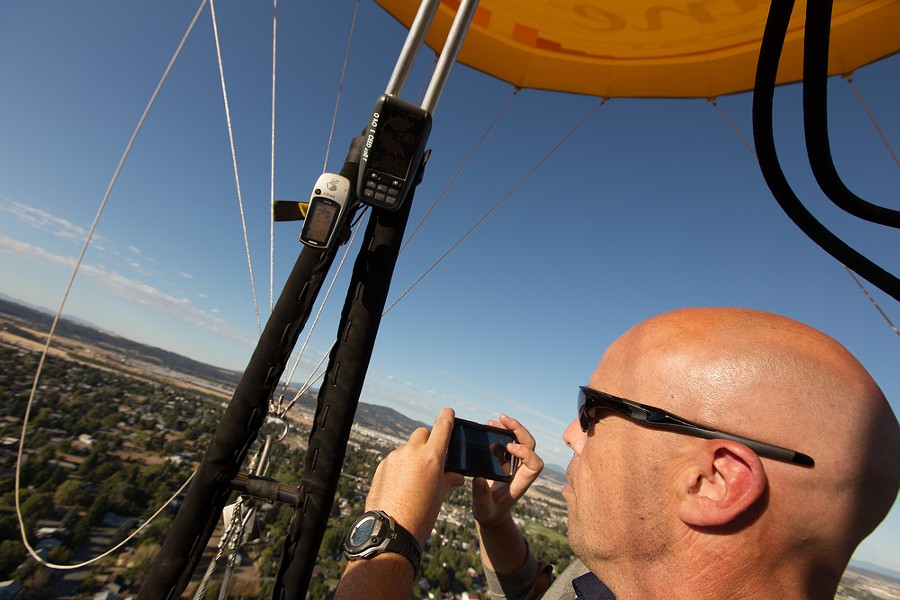 Passenger Shane Copenhaver photographs the landscape during a hot air balloon ride. - YOUNG KWAK