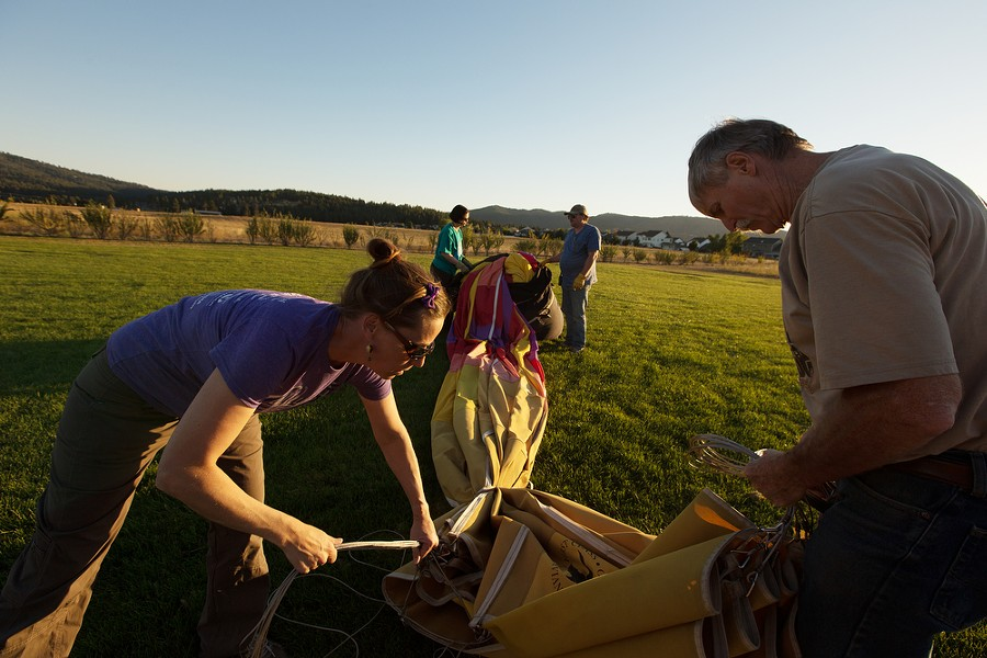 Balloons Over Valleyfest Committee Chair Stephanie Hughes, left, and Pilot and Owner Forey Walter tie the shroud lines before packing the last of the envelope into a storage bag after a hot air balloon ride. - YOUNG KWAK