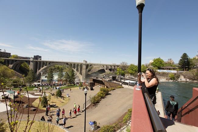 Deb Soccumtickem takes a photo of Huntington Park. - YOUNG KWAK