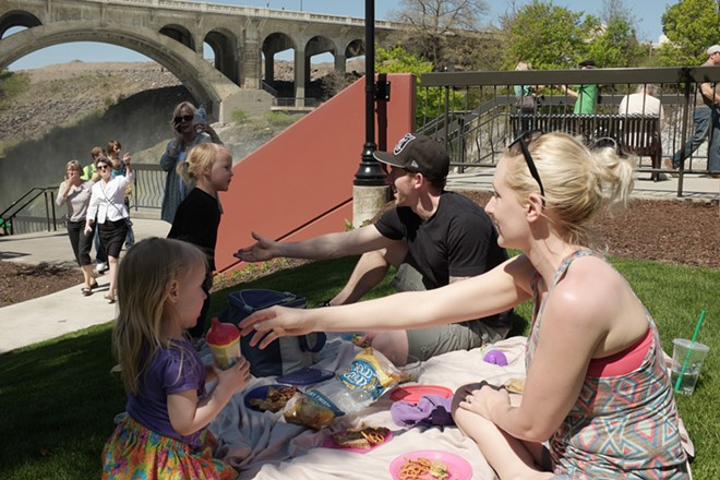 Terran McCabe, right, her husband Jesse, second from the right, and their 2-year-old daughters Devon, left, and Fredi have a picnic. - YOUNG KWAK