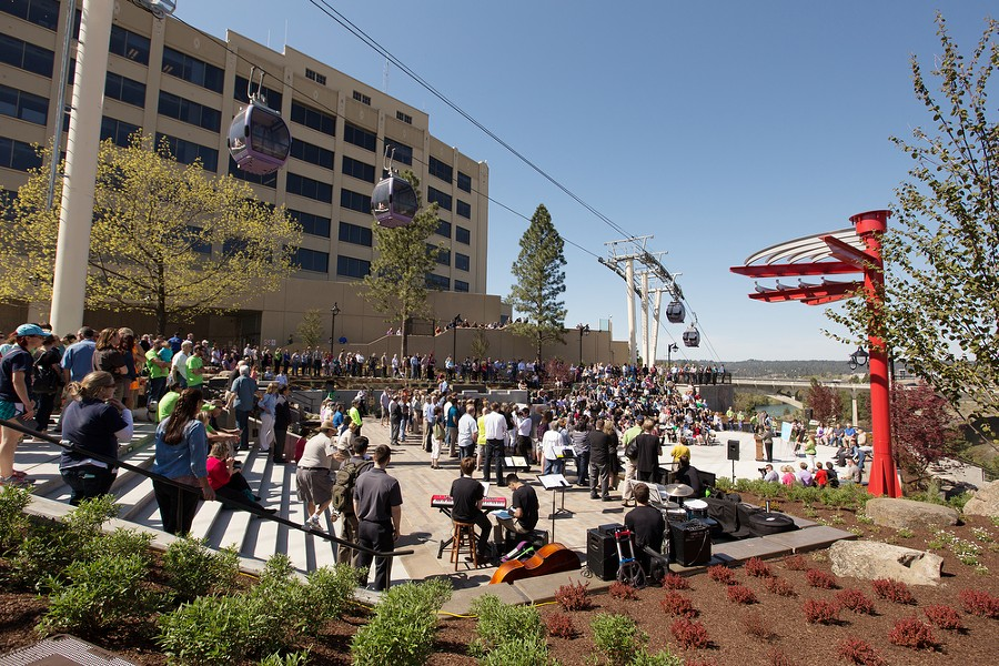 People gather to watch a speaker during the dedication. - YOUNG KWAK