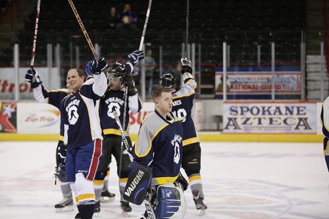 The Spokane Police Department team celebrates after winning a hockey game against the Spokane County Sheriff's Office. - YOUNG KWAK