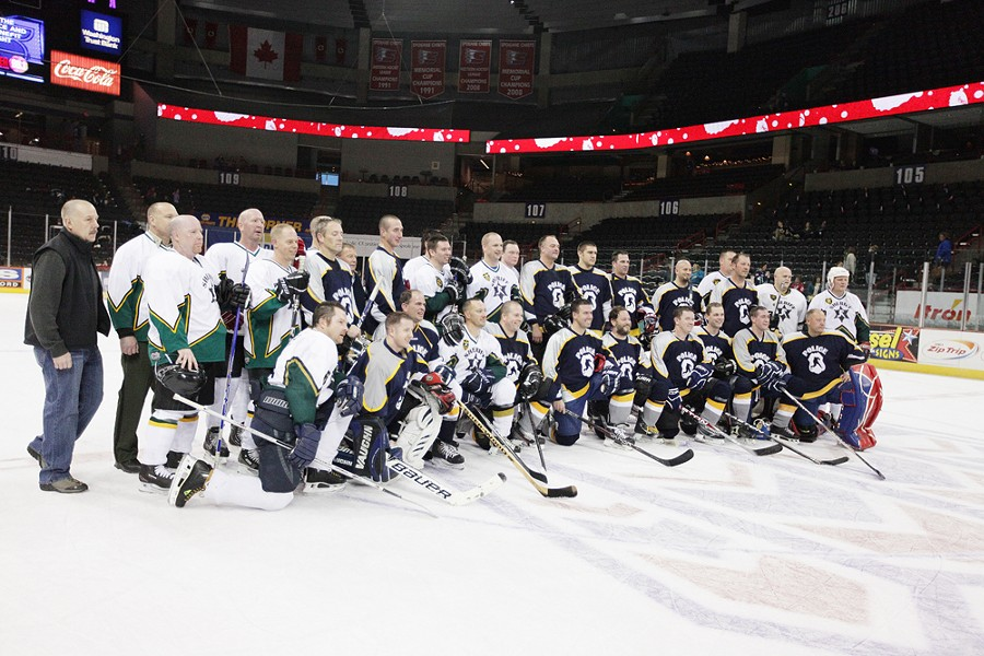 The Spokane Police Department and the Spokane County Sheriff's Office teams pose for a photograph after a hockey game. - YOUNG KWAK