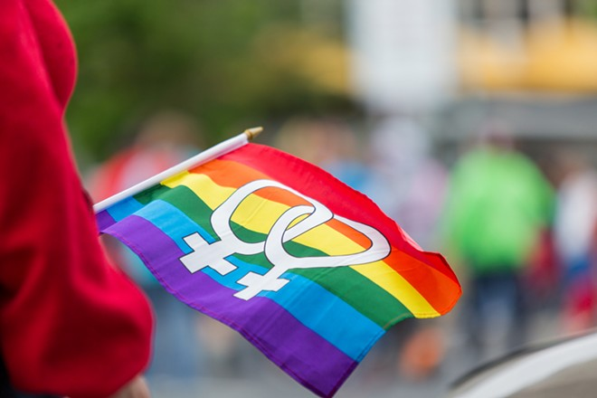 An equality flag waves in the wind at the Pride Parade. - MATT WEIGAND