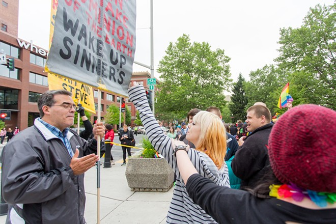 Cherish Hood argues with a man protesting against same-sex marriage. - MATT WEIGAND