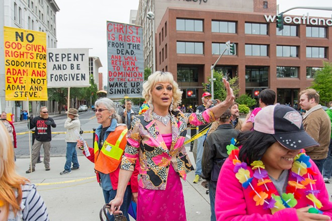Bart Deen aka Savannah Soked encourages people to move away from the parade protesters. - MATT WEIGAND