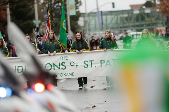 The banner of the Friendly Sons of St. Patrick is carried at the beginning of th St. Patrick's Day Parade. - YOUNG KWAK