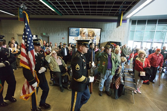 A Joint Military Color Guard enters during a Veterans Day Ceremony. - YOUNG KWAK