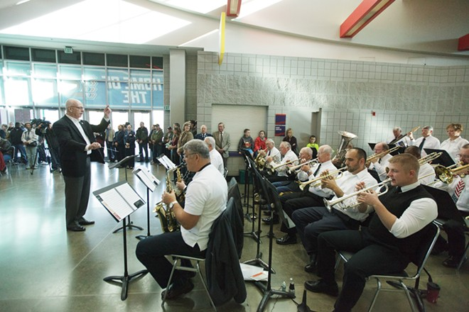 "The 560th Air Force Veterans Band performs a ""Military Service Medley"" during a Veterans Day Ceremony. - YOUNG KWAK"