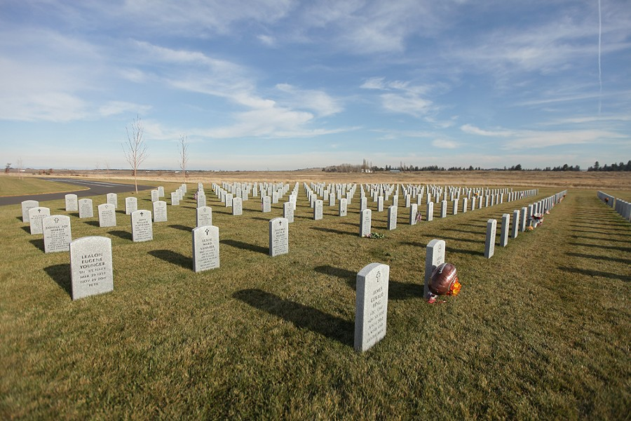 Flowers and flags are left at the Washington State Veterans Cemetery. - YOUNG KWAK