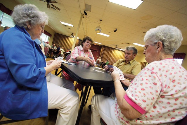 Pinochle has been a constant at Spokane's first senior center. - YOUNG KWAK
