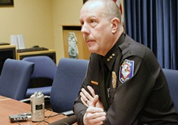 Spokane Police Chief Frank Straub speaks with reporters and TV crews Wednesday afternoon.
