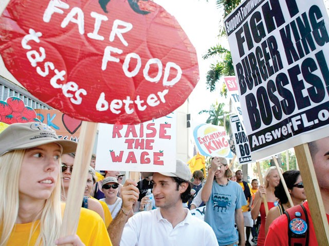 Protesters with the Coalition of Immokalee Workers march in Miami in 2007. - [PHOTO: JOE RAEDLE/GETTY]