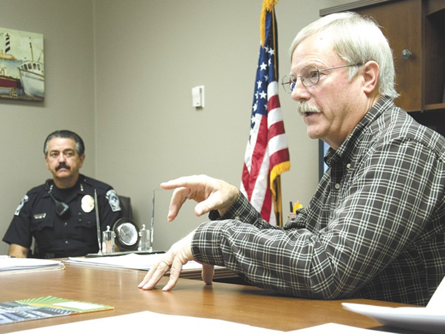 Quincy Mayor Jim Hemberry, right, and Police Chief Richard Ackerman say a new $130,000 computer program will help curb gang activity. - NICK GAST