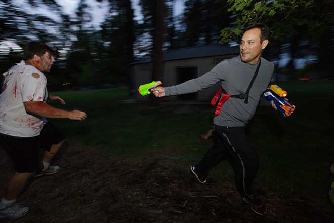 Race participant Jim Carbajal, right, shoots zombie Caleb Heath. - YOUNG KWAK