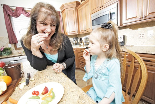 Resa Hunt shares a snack plate with her 4-year-old granddaughter Charesa in Spokane Valley. - YOUNG KWAK