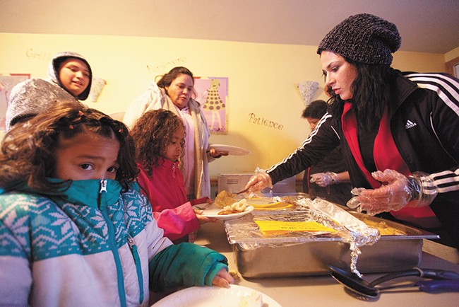 Resident Brianna Arena, right, serves dinner to fellow residents at the Union Gospel Mission shelter. - YOUNG KWAK