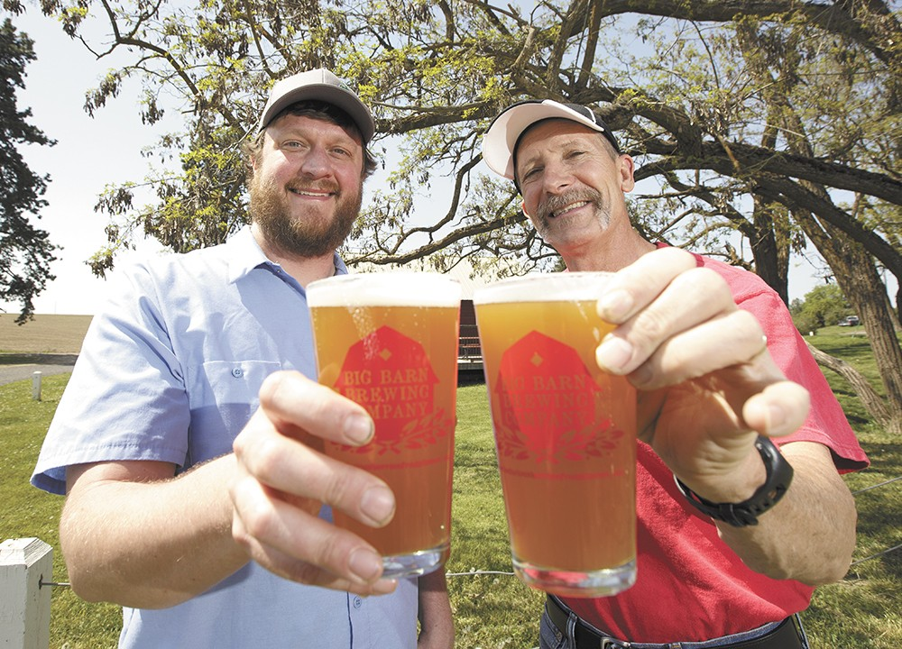 River City Brewing's head brewer, Moose Sanders, left, and Big Barn Brewing Company co-owner Craig Deitz with pints of their Spokane Craft Beer Week