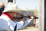 "Roger ""Hop Along Hoot"" Sherman fires his Hartford 92 rifle during a Windy Plains Drifters match in Medical Lake on July 13."