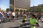 Runners begin their race.
