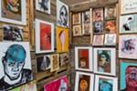Ryan Desmond displays his paintings at his booth.