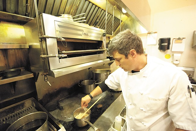 Santé executive chef and owner Jeremy Hansen adds salt to risotto. - YOUNG KWAK
