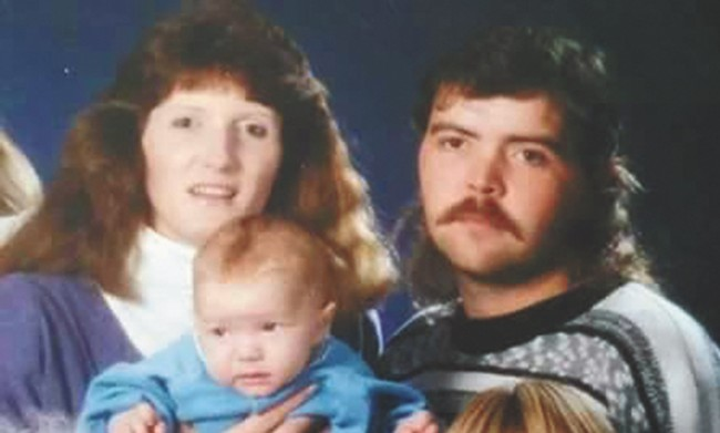 Sara Elkhiyati and John Everitt, with Levi as a baby.