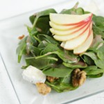 Scratch Signature Salad with baby spinach, bacon, brie, apples, candied walnuts and pomegranate vinaigrette.