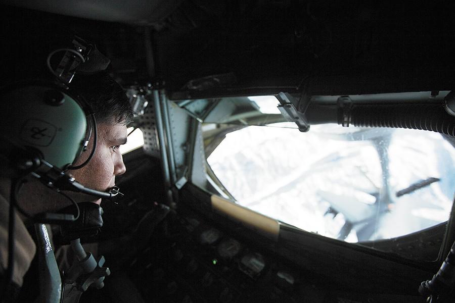 Senior Airman Dave Fernandez refuels an F-16 from a KC-135. - YOUNG KWAK