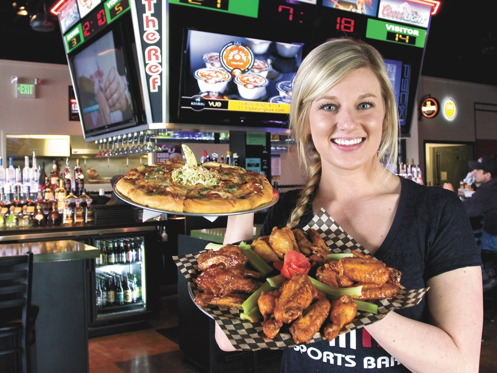 Server Jen Has shows off The Ref's wings and pizza. - JEFF FERGUSON