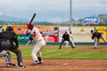 Seth Spivey (11) eyes an incoming ball as the Spokane Indians play the Eugene Emeralds.
