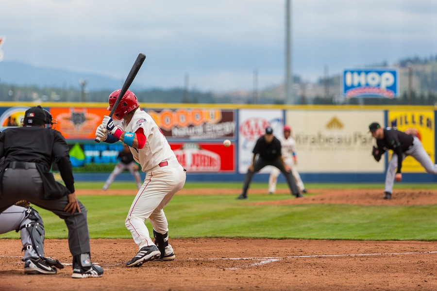 Seth Spivey (11) eyes an incoming ball as the Spokane Indians play the Eugene Emeralds. - MATT WEIGAND